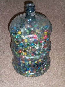 57 POUNDS OF MARBLES.