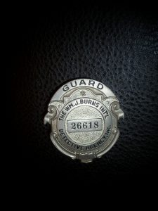 OLD BADGE.